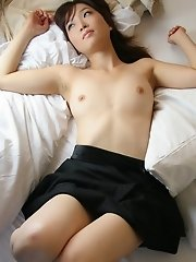 Naughty Koto takes off her top to show tits