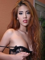 Redhead Asian Arya in sexy lingerie